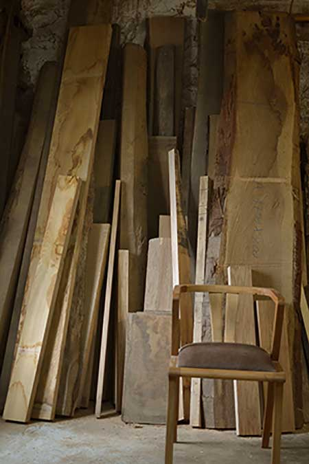 Wood stack in the Makers furniture workshop - with Zen chair