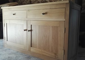 Large oak sideboard with two dovetail drawers and two doors