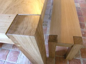 contemporary oak dining table and bench corner detail