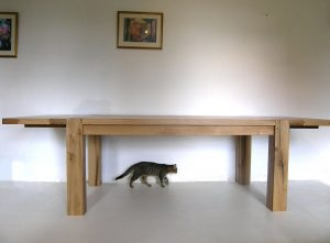 Contemporary oak dining table with extensions