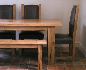 Bespoke oak dining table and upholstered chairs