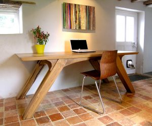 Angled leg dining table