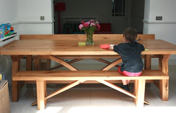 Bespoke oak dining table and bench for a London client