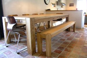 Contemporary oak dining table and bench to match