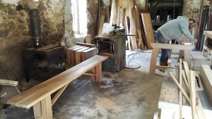 Sanding and oak table base in the Makers workshop