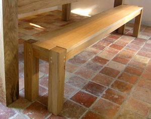 Contemporary oak dining bench by Makers