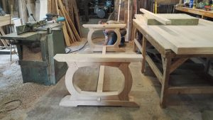 Curved oak table base in progress in the workshop