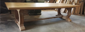 Refectory table with curved base