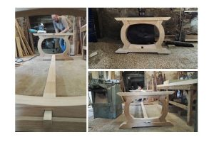 Curved oak refectory table in the workshop