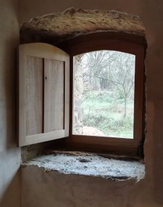 Arched window with oak shutter