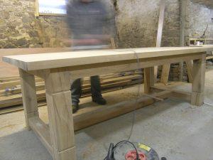 Bespoke oak refectory table in progress in the workshop