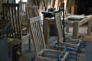 Handmade oak dining chairs in the workshop