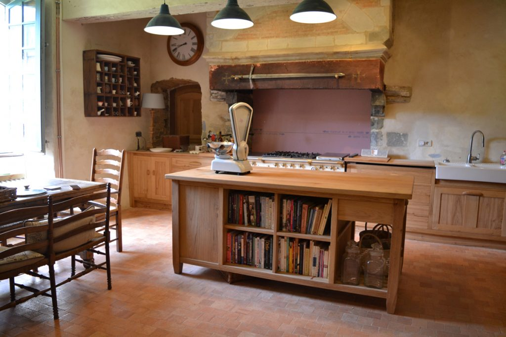 Oak kitchen island with book shelves and storage