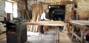 Oiling a table top in the Makers furniture workshop