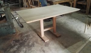 Small oak dining table with angled top
