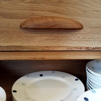 Oak drawer with curved handle