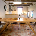 Arch leg dining table