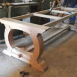 Bespoke curved oak table base in the workshop