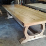Curved base refectory table in the workshop
