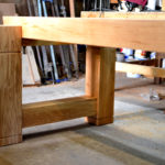Large chunky oak dining table in the workshop