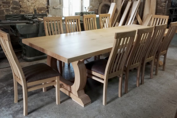 Bespoke refectory table and 10 chairs in the workshop
