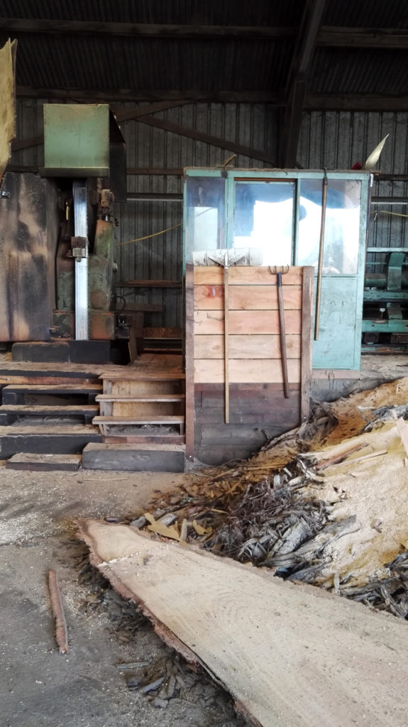 Old French woodworking machines with sawdust and tools