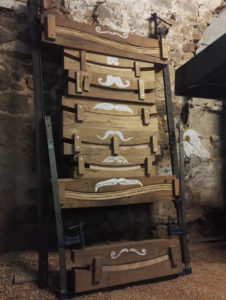 Chair back slat in their moulds after steaming