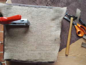 Applying the hessian to the underside of the chair seats