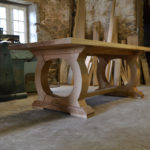 Bespoke table with curved base