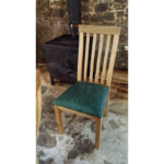 High back oak dining chair with green leather seat