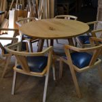 Round oak table with 6 bespoke chairs